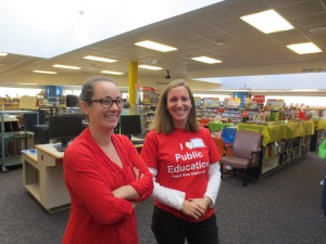 Volunteers wearing red are ready to help in the library!