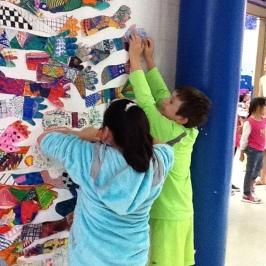 Students work on display
