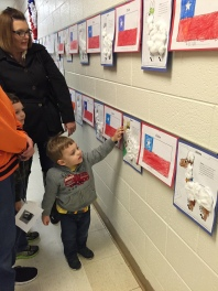 K student shows his family his work